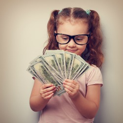 bigstock-Happy-Kid-Girl-In-Glasses-Look-97346081