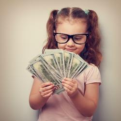 bigstock-Happy-Kid-Girl-In-Glasses-Look-97346081