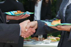 Business-Handshake-During-Lunch