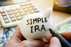 SIMPLE IRA written on a piggy bank.
