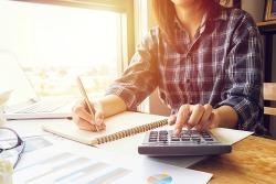 tax savingsAsian-Business-Woman-Using-Cal-234139735
